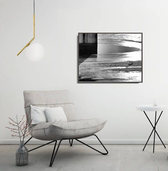 Black and white photo poster with modern landscape motive. Contrasting light and shadows of frozen river, geometric pattern of concrete pillar - a modern motive for living room, office or industrial interiors. Poster is available in multiple sizes: 8 x 10 in, 12 x 16 in, 16 x 20 in, 18 x 24 in, 24 x 36 in. +++ #wallart #walldecor #geometric #geometricposter #geometricartprint #moderngeometric #industrialdecor