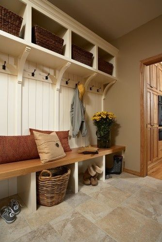 "Corbels instead of a full ""locker"" look. Keeps it open but helps create separate areas. Plus, it's easier to clean than a storage bench seat would be."