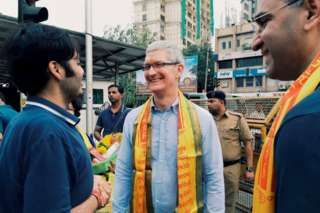 Image copyright                  AP                  Image caption                     Apple CEO Tim Cook wants to expand Apple's reach in India   Less than seven hours after a midnight landing in India, Apple CEO Tim Cook was spotted in a famous Hindu temple in Mumbai on Wednesday.  He was seen there with Anant Ambani, son of Reliance Industries chairman Mukesh Ambani, whose Jio 4G service is expected to be a game-changer for mobile internet in India