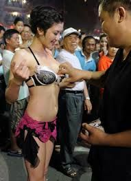 Strippers – Taiwan Yep, strippers. In Taiwan, it's thought that spirits in the afterlife fare better if the funeral is a fun occasion. Therefore, funerals have become quite the party. Large crowds are encouraged. Some funeral planners have even gone so far as to hire strippers for the event. In fact, groups of strippers travel around Taiwan in buses, funeral hopping to entertain mourners and encourage more to attend