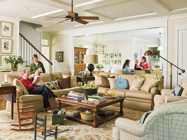 Double couch. Two couches. Double sofa. Two sofas. Family is the focus in this spacious living room. With plenty of seating, warm colors, and classic, easy-care pieces, this living room feels both traditional and modern. (Photo: Erica Georges Dines)