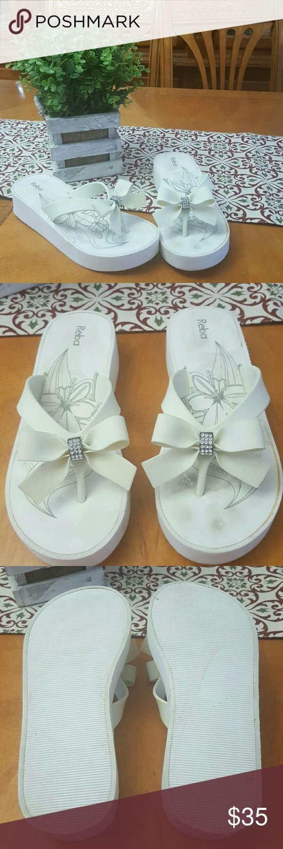 Reba white wedge rhinestone bow flip flops These were my comfy wedding flip flops. A little dirty and it looks like the glue on the sole has discolored but they can be cleaned. Super cute for wedding day! Reba Shoes Sandals