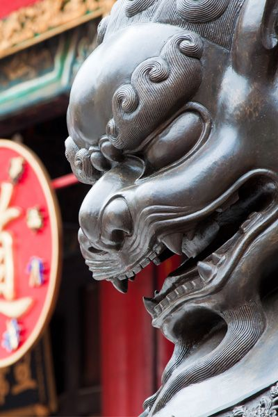 There's a practical approach to prayer at one of Hong Kong's most exuberant places of worship, the Sik Sik Yuen Wong Tai Sin Temple.  Here the territory's three major religions---Taoism, Confucianism, and Buddhism---are all celebrated under the same roof.