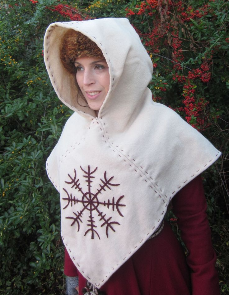 The pattern is based on the original Skjoldehamn hood, an archaeological find at Skjoldehamn (Skjold harbour) on the Norwegian island of Andøya, dated from between 995 to 1029 CE. This hood is made of a cream wool, and is entirely hand-sewn with a matching wool thread. I have included decorative stitching around the edges, as well as contrasting embroidery on the front panel in deep red/burgundy wool thread.