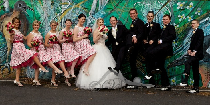 The wildlife mural on the levy wall made a great backdrop for this bridal party photo