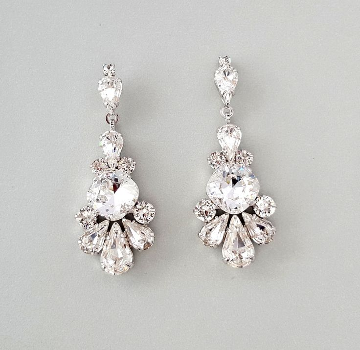 "Alanna Earrings by Ambrosia Bridal©  Crystal Bridal Earrings in vintage style. Chandelier earrings in rhodium  silver with genuine Swarovski crystals in a beautiful drop shape.  Earrings are 2 3/16"" Length - 1 1/8"" width"