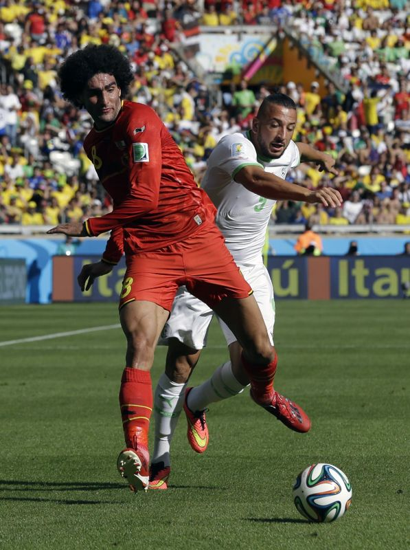 Belgium's Marouane Fellaini, left, and Algeria's Nabil Ghilas battle for the ball during the group H World Cup soccer match between Belgium and Algeria at the Mineirao Stadium in Belo Horizonte, Brazil, Tuesday, June 17, 2014