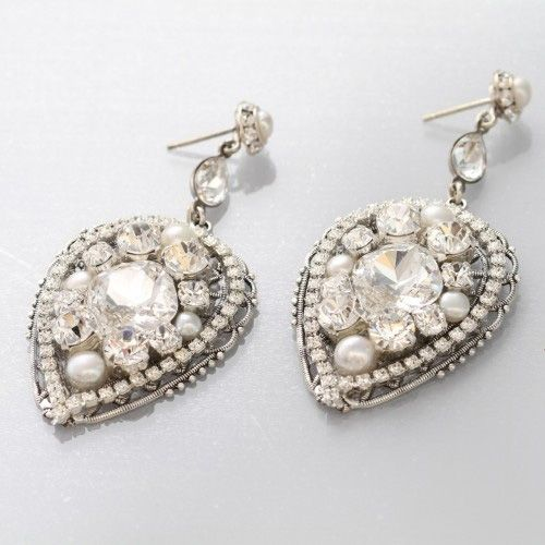 Hanging teardrop earring with crystals and pearls.  Bridal Accessories available at Cocoa Couture Pinned from www.dreamweddingspa.com
