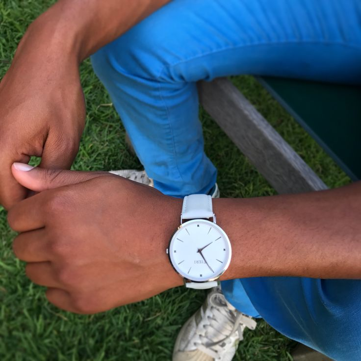 Classic silver watch with light grey leather strap