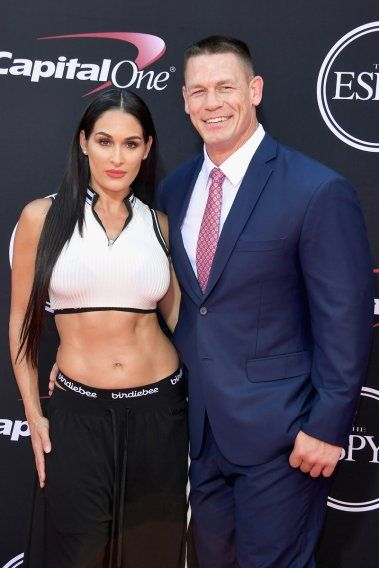 Professional wrestling power couple John Cena and Nikki Bella were both camera-ready, with Bella showing off her impressive physique.
