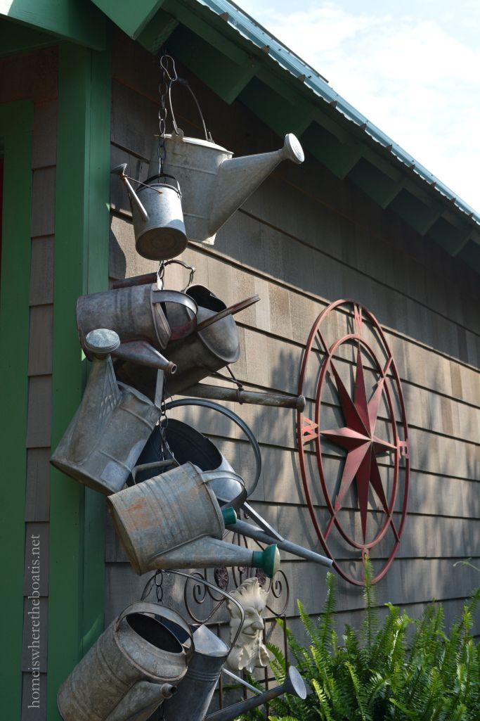 Watering Cans hanging on chain Potting Shed | homeiswheretheboatis.net