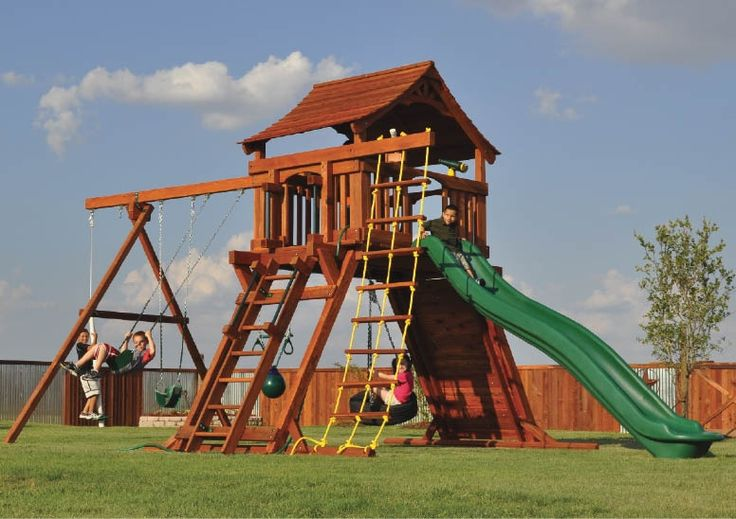 Fort Ranger playset with rope ladder climber, deck ladder, rock wall, slide, tire swing, and swings.   #swingset #playset #kids #outdoorplay #outdoors @mybackyardfun