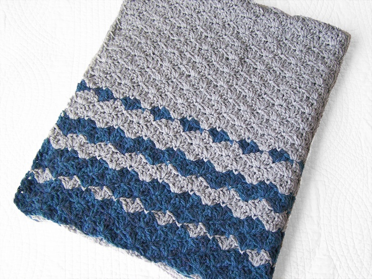 Crochet baby blanket - looks like a simple shell with a color changing back and forth on the edge increasing the rows of B color.