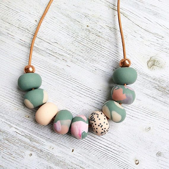 Make a statement with this handmade soft jungle green, pastel blush and pink necklace. Each polymer clay bead has been individually hand rolled, giving them character. All strung on 27in long genuine natural leather with a clasp at the back. Every necklace is made with love and care.