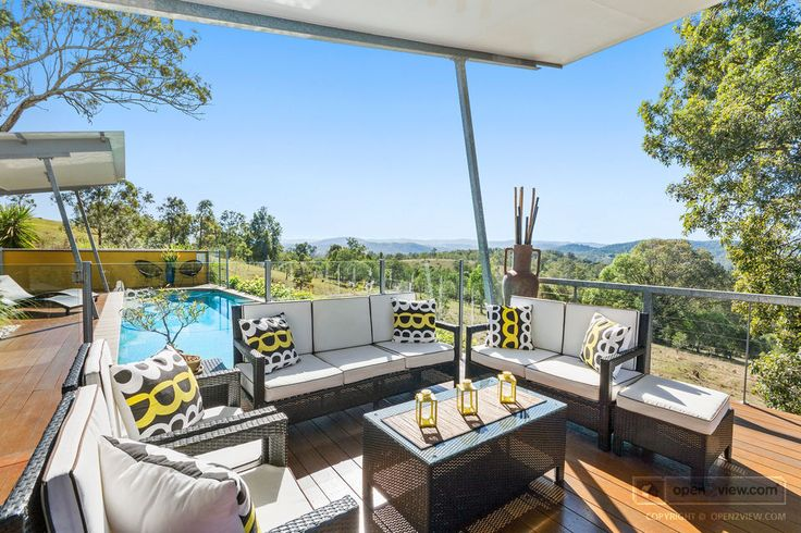 This property's unique design takes full advantage of the panoramic views that its elevated hilltop position offers...
