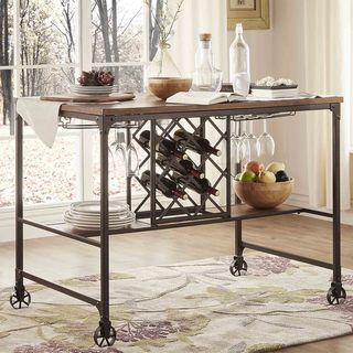 Introduce simplicity and transitional functionality with this modern industrial style bar table. Ideal for entertaining, this table comes complete with stemware rack, wine rack and shelving for storag