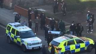 Two teenagers stabbed outside Manchester college