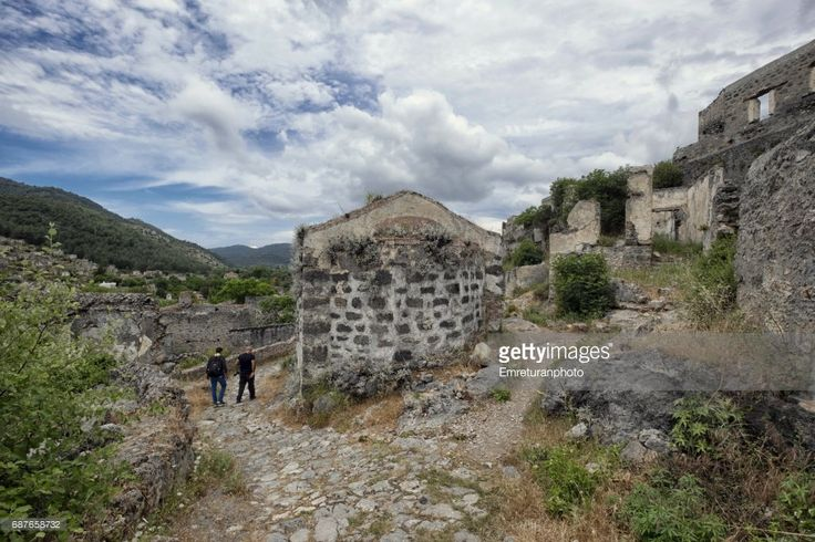 Tourists wandering in the abandooned streets of the Ottoman Greek village of Kayakoy near Fethiye.The town was abandoned completely after the independence war of Turkey;it was built on the ancient Lycian city of Lebessos and was called Livissi and had a population of 6,000.