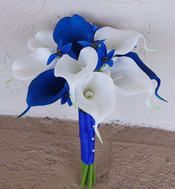 Or just keep calla lillies in 2 colors...silk Wedding Bouquet with Blue and White Calla Lilies  by Wedideas
