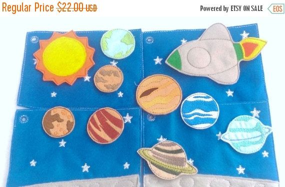Space - planets play set for your favorite space lovers.  This set has 4 pages tied together with a ribbon, the first page has a felt pocket on the back to hold all of the planets and space ship. Each page is made of felt with machine embroidered details and backed with another piece of felt. The pages are very sturdy and will stand up to the wear and tear a child can put them thru.  This space set is perfect to keep children busy during church, car rides, Dr.s office visit, plane rides, or…