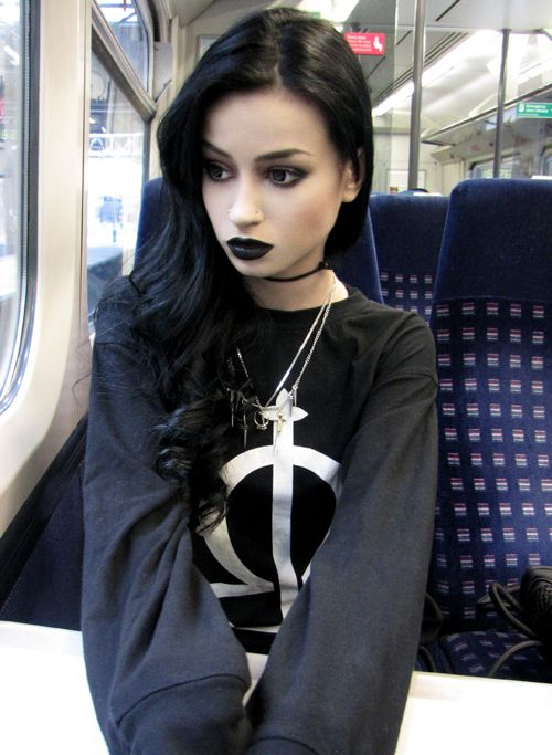black lipstick black hair trains transport moving cross cruifix eyebrows