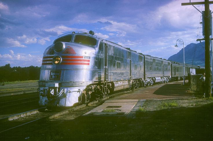 "C&S E5 9955 | Colorado & Southern Railroad E5 9955 at the AT&SF station in Colorado Springs, Colorado on August 19, 1964, Ektachrome by Chuck Zeiler. Built as CB&Q E5 9914A (c/n 1301), named ""Silver Arrow"", sold to C&S September 20, 1961, traded to EMD March 15, 1968. It is seen here northbound at the AT&SF station with the daily unnamed Train #8 which originated in Houston, Texas the day before, and will terminate in Denver at 6:..."