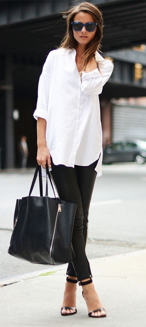 White shirt and black trouser with a black side-bag.