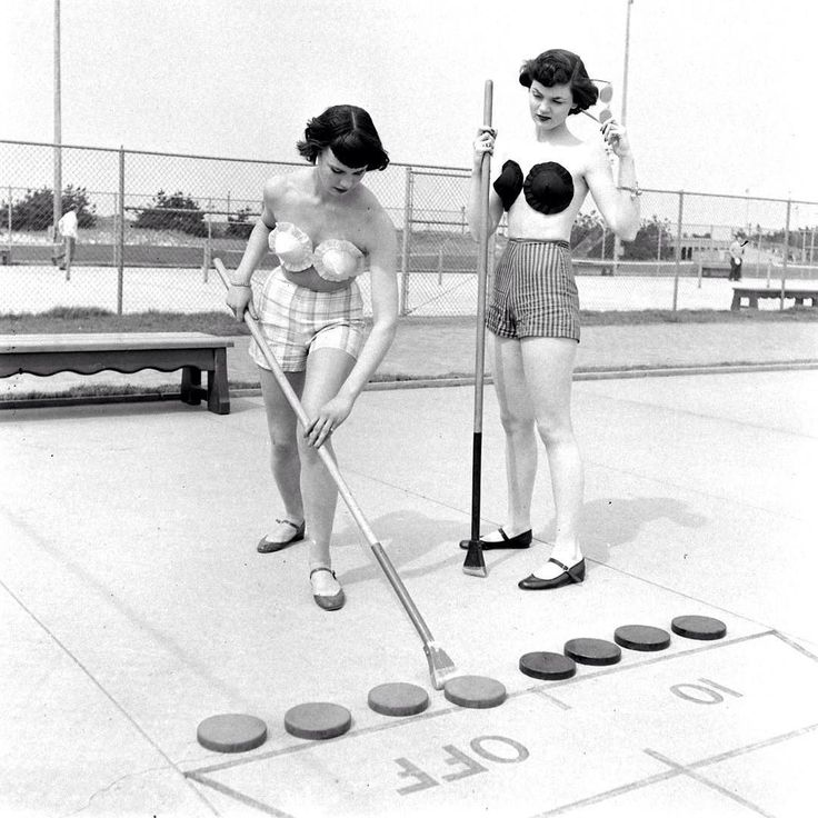 Two models play shuffleboard while wearing a fashion trend that never quite stuck: adhesive bras (Nina LeenThe LIFE Picture Collection/Getty Images) #fashionfriday - by life (LIFE) || #Vintage #Photography