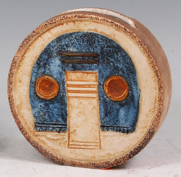 34 - A Troika pottery circular slab-sided vase