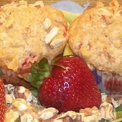 A quick and simple muffin recipe with sweet strawberries and crunchy walnuts.