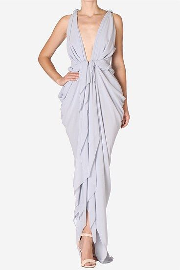 Sky Forget Me Knot Gown  This layered georgette gown flatters the figure with its plunging neckline and soft draping. Platted detailing adds a Grecian touch, complete the look with hair swept up.