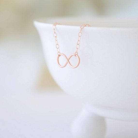Olive Yew's tiny infinity charm necklace is handmade and hand hammered. Let someone special know your love for them has no end with this necklace available in silver, gold and rose gold.