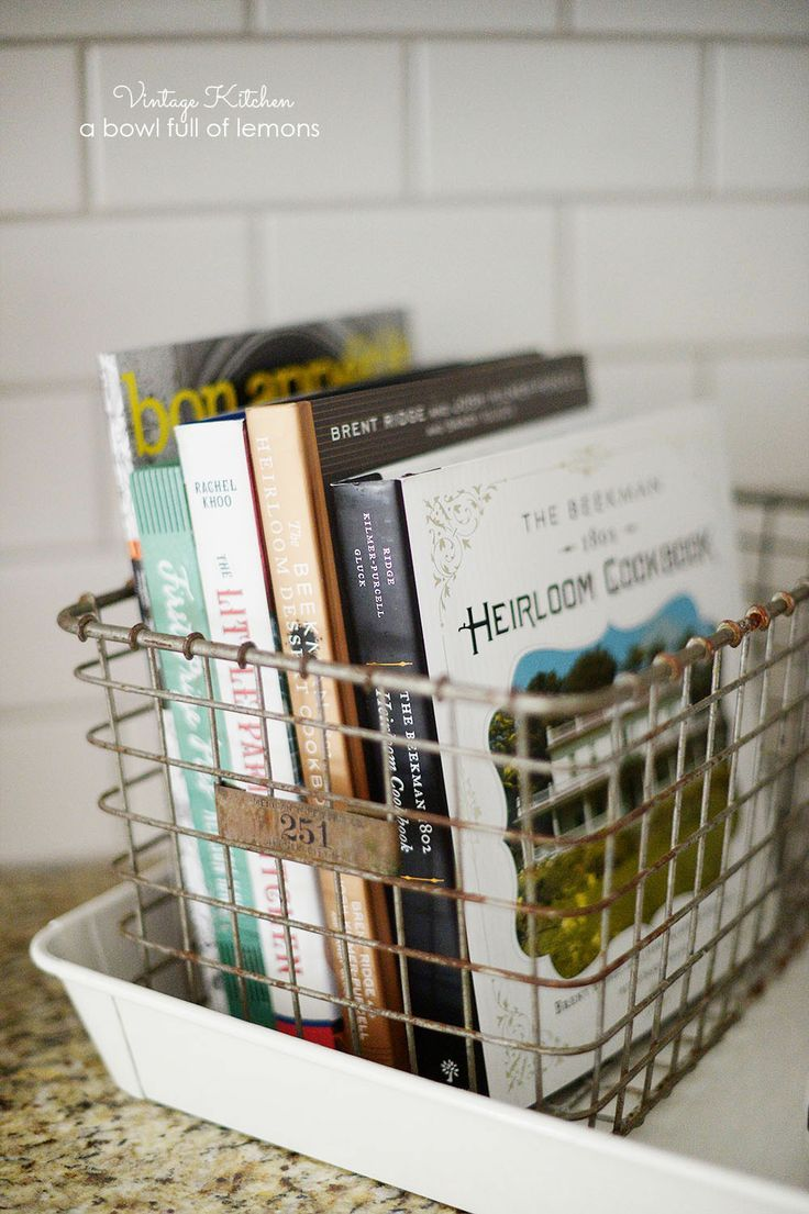 organize cookbooks in a vintage basket