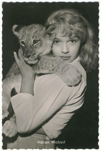 0 Marion Michael holding a lion cub