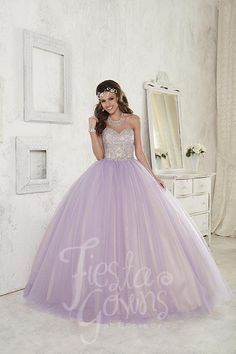 Strapless sweetheart ball gown with bead clustered bodice and a sparkle tulle, two-tone skirt. Download the Fiesta Gowns by House of Wu sizing chart here. *Note lead times for dresses will vary. All i