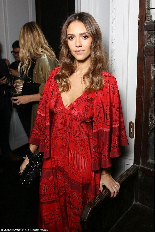 Turning heads: Jessica Alba continued the red theme as she put on fiery display at the Par...