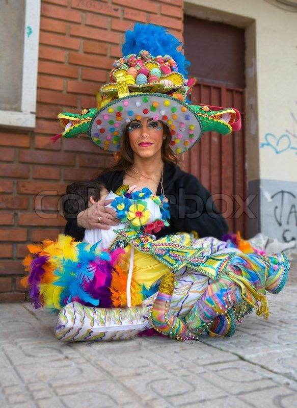 BADAJOZ, SPAIN, MARCH 4: Performer gives milk from breast after the Carnival parade of comparsas at Badajoz City, on March 4, 2014. This is one of the best carnivals in Spain, renown by all the national news media and especially highlighting massive participation of people. | Stock Photo | Colourbox on Colourbox