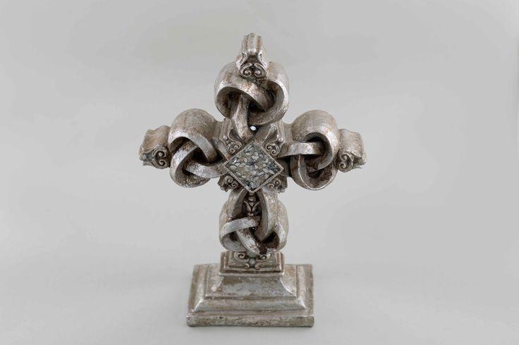 Ornamental cross in aged silver.