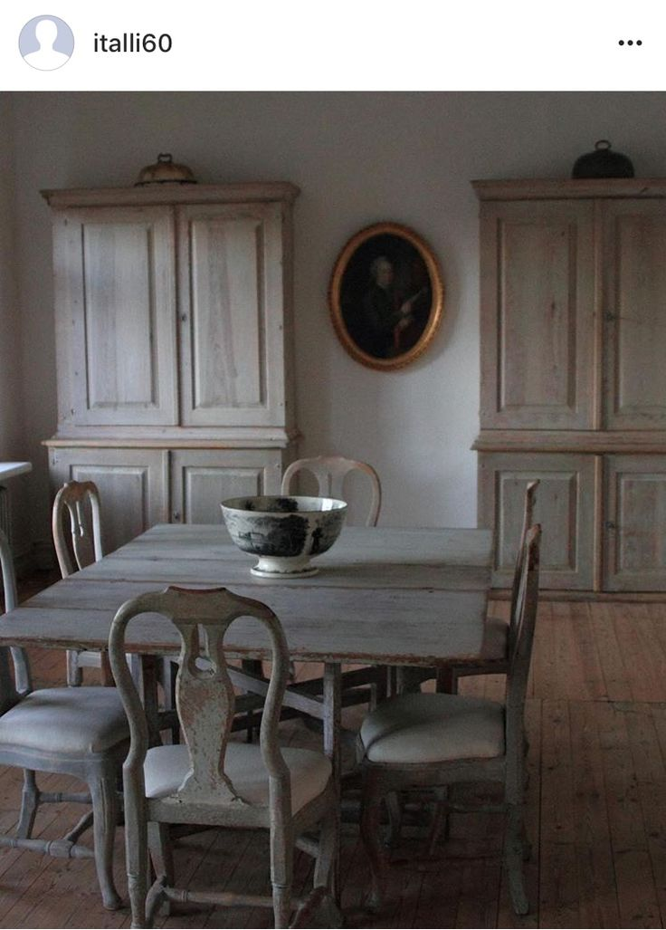 Painted Swedish armoires and table—dusty blue-whites.