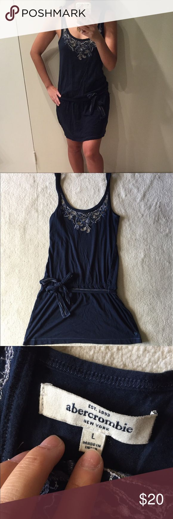 Navy blue Abercrombie dress Navy blue Abercrombie kids dress with floral details. Kids size L but fits like adult S. No trades. Gently used in good condition. Please ask all questions before purchasing and use the offer button, thanks! abercrombie kids Dresses
