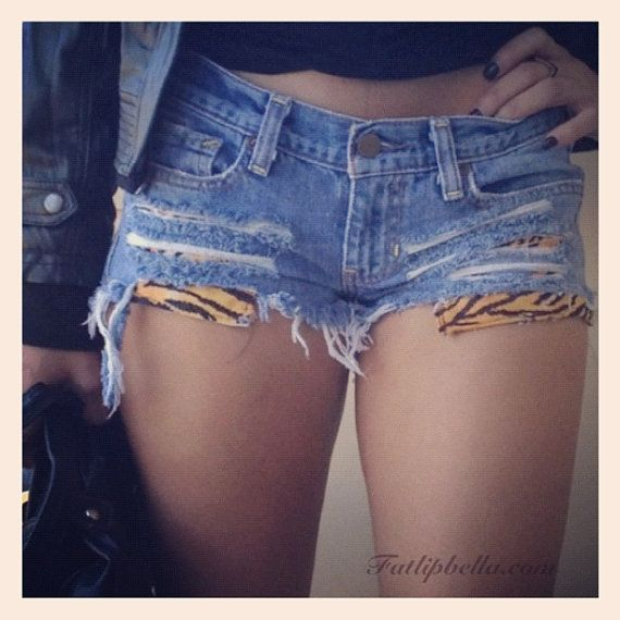 distressed ripped shorts with tiger strip print by ZamGhuden, $29.99