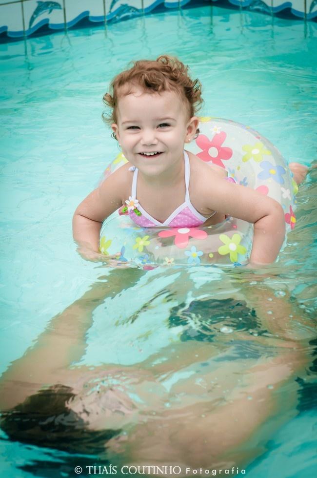 in the pool  http://fotosealbuns.com/blog/2013/01/piscina-e-banho-de-chuva-na-sessao-de-fotos-lifestyle-de-carolina-parte-2/