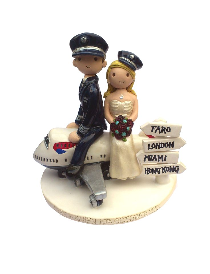 Plane cake topper, with two pilots x http://www.wedding-cake-toppers.co.uk/  sooooo cute!