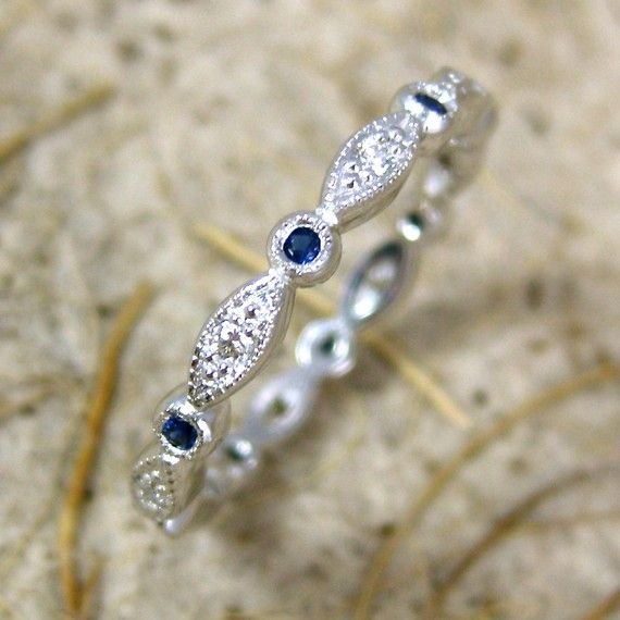 round - oval diamond and sapphire wedding band