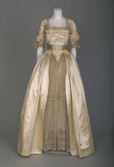 Wedding dress, Lucile, silk satin trimmed with self-fabric and blue satin, organdy, chantilly lace and silk flowers over underskirt of organdy with lace insert, 1916, American.