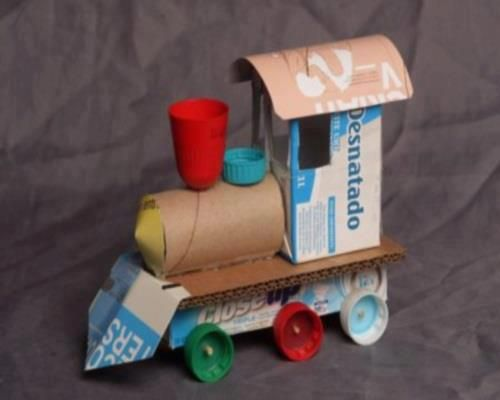 Child's train made from cardboard containers, bottle caps & toilet paper rolls.