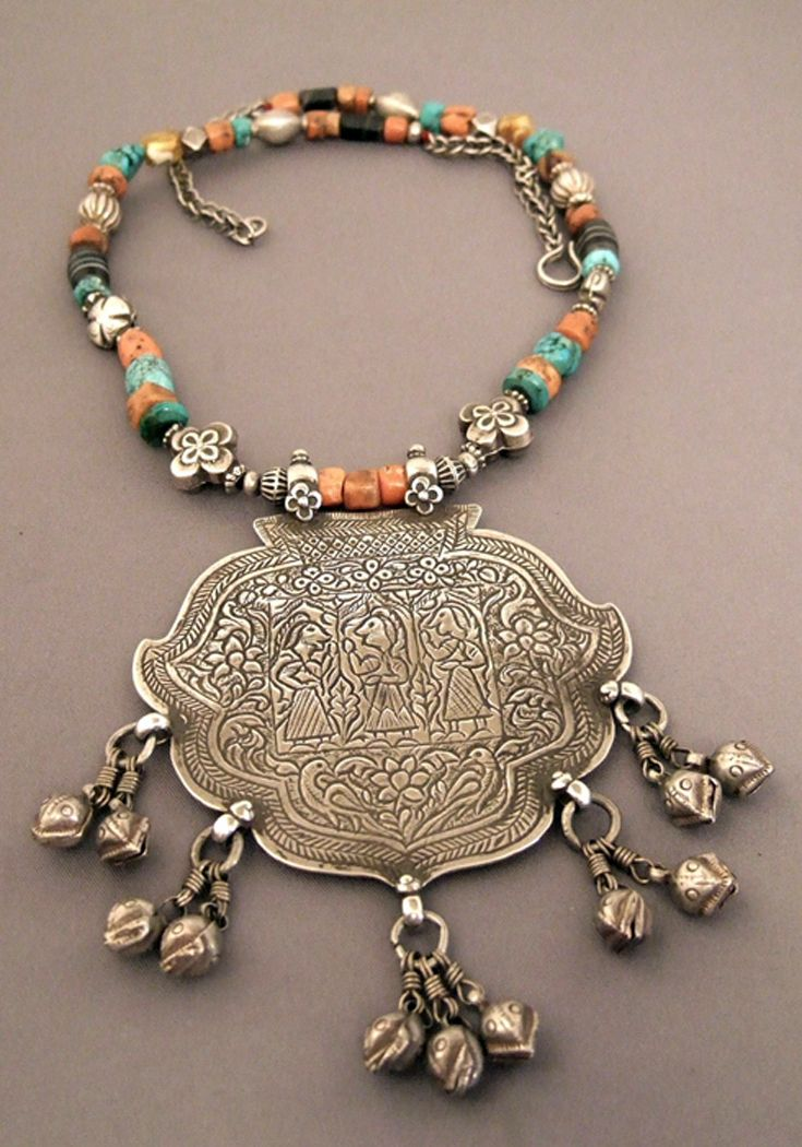India | Necklace; silver, coral, turquoise, amber, agate from Himachal Pradesh | Antique silver amulet dedicated to three local Hindu divinities and pretty floral motives | Sold