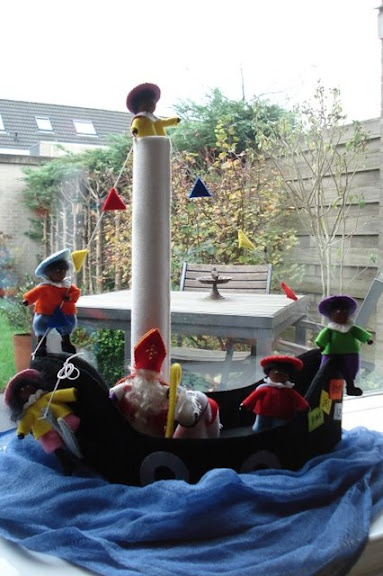 Sinterklaas and his Zwarte Piets arriving on his boat.