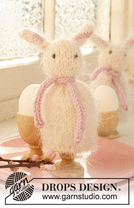"""Knitted DROPS egg warmers for Easter in """"Symphony""""."""