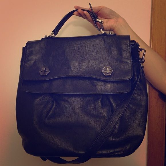 Anthro black leather purse Anthro black leather purse. Leifsdottir brand. Like new condition, barely there wear on the twist clasps on the front, super clean interior, I only used a handful of times. Lots of space! Anthropologie Bags Shoulder Bags